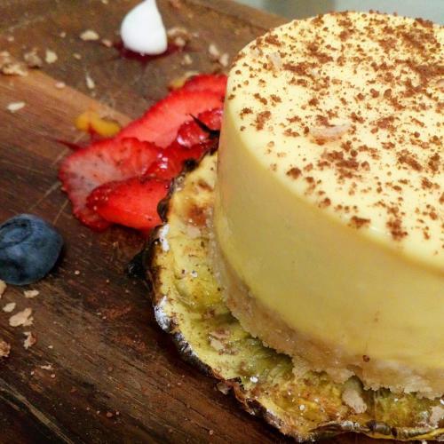 Passionfruit cheesecake, caramalised pineapple, berry salad, meringue kisses
